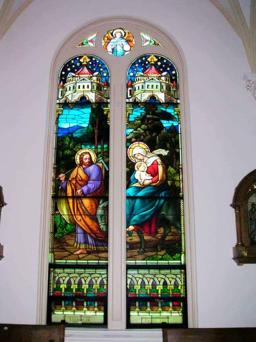 Stained glass window of Jesus, Mary, and Joseph fleeing into Egypt in the Chapel of the Incarnate Word.